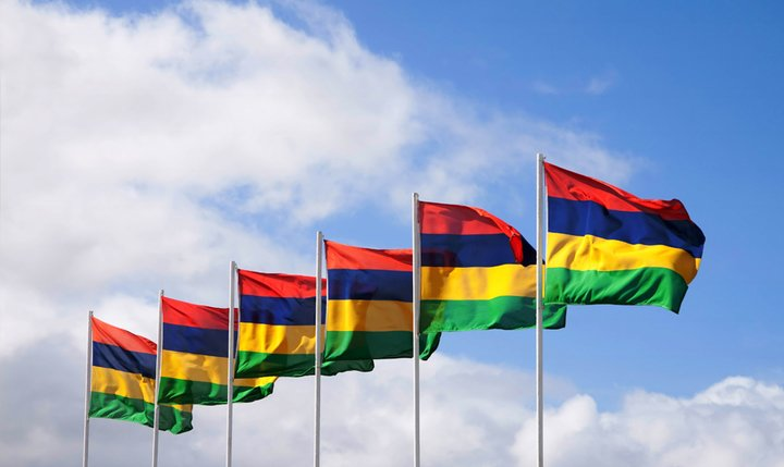 mauritian flags floating in the air at sugar beach mauritius